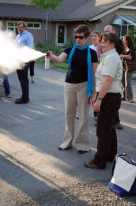 Mindy O'Neall takes her turn using inert bear spray at Campbell Creek Science Center