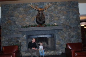 Stay cozy by the huge fireplace in the Alyeska Grand Hotel.