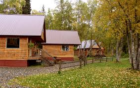 Individual cabins line the Susitna River in Talkeetna. {Susitna River Lodge}