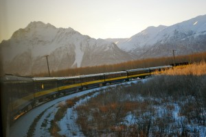 The Aurora Winter Train makes a turn near the Palmer-Wasilla area near sunrise.