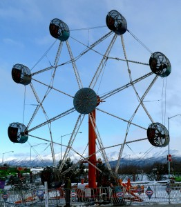 A carnival, complete with rides, dominates the skyline of Anchorage during the Fur Rendezvous festival each February.