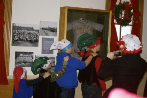A cadre of elves pose for a photo op in the Anchorage depot.