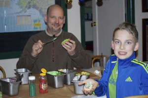 AK Dad and Kid enjoy some cookies they decorated at Talkeetna Roadhouse.