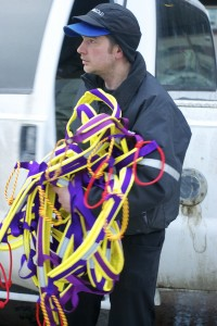 A musher unloads harnesses for his team. Each dog has a harness sized to his or her body, as one too large or too small can impede progress and cause chafing.