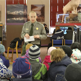 Kids enjoy a bit of information at the Alaska Public Lands Information Center in Anchorage. [nps.gov]