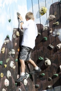AK Kid tackles the climbing wall at Talkeetna's community playground. Erin Kirkland/AKontheGO