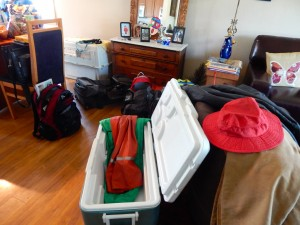 Rain gear and cooler, backpacks and hats, all stand ready for a trip down the Aleutian Chain. Erin Kirkland/AKontheGO