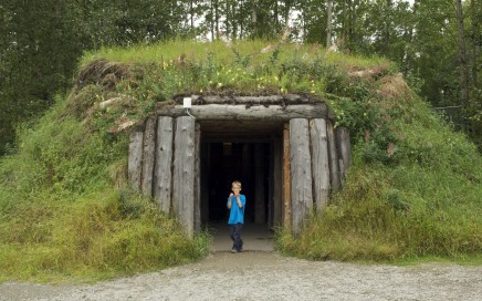 AK Kid checks out an authentic dwelling at the Alaska Native Heritage Center in Anchorage. Erin Kirkland/AKontheGO