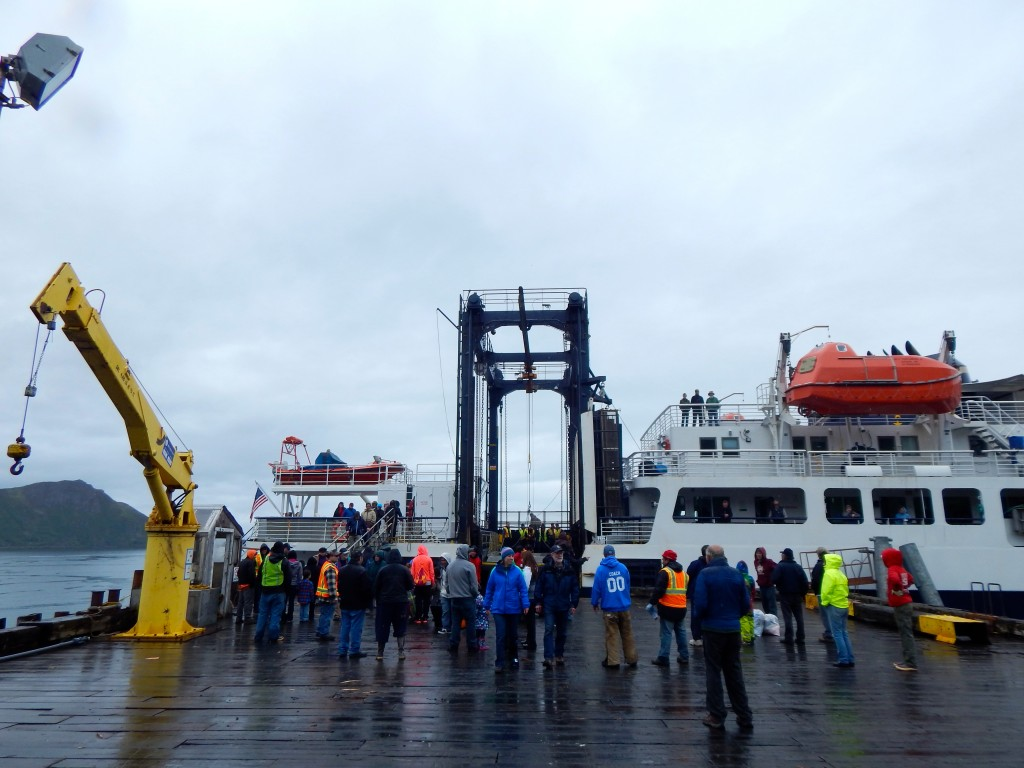Residents of Chignik, Alaska gather around the recently arrived M/V Tustemena on a recent afternoon. Erin Kirkland/AKontheGO