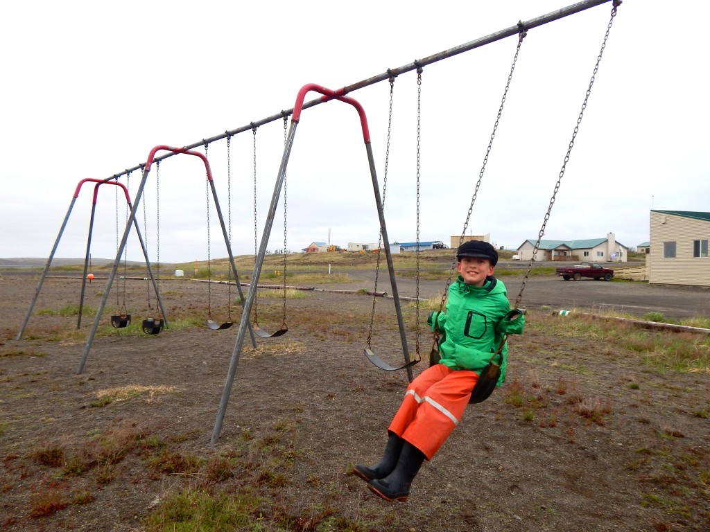 AK Kid finds the community playground in Cold Bay, Alaska, along the Southwest ferry route.