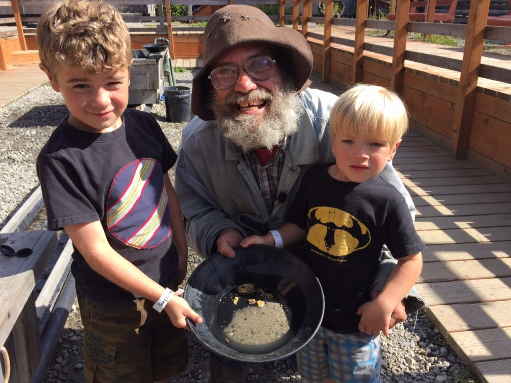 """""""Sourdough Sam"""" shows the kids how gold panning is done at Klondike Gold Fields in Skagway. Image by Steve SueWing."""