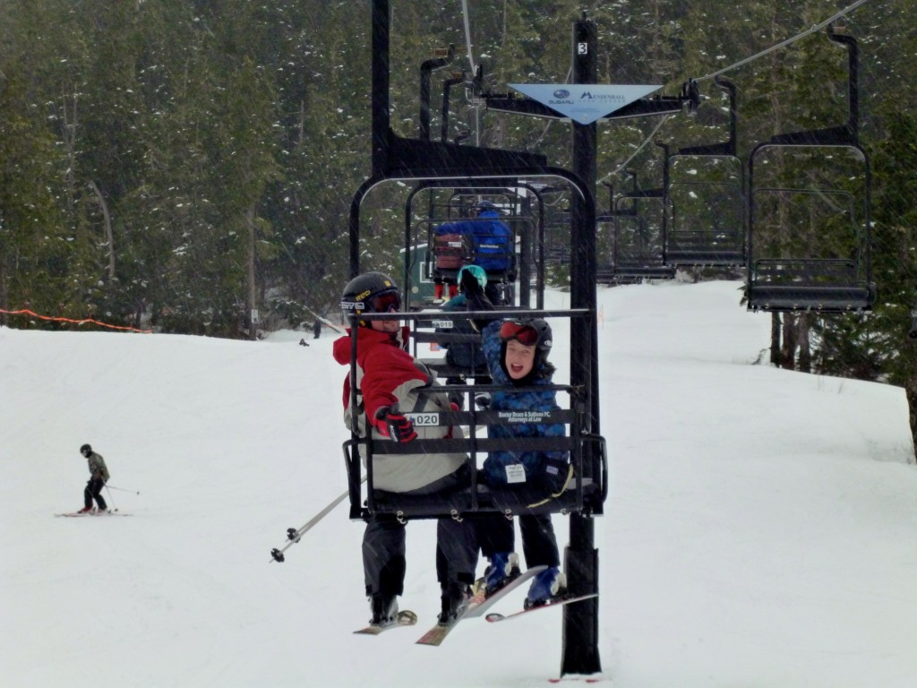 AK Dad and Kid head up the Porcupine lift at Eaglecrest Ski Area in Juneau.