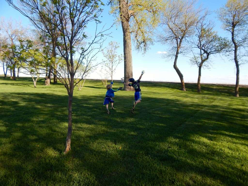 Playing underneath the towering trees at a North Dakota park. Erin Kirkland/AKontheGO