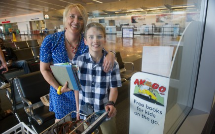 AK Kid helps stock shelves near the ticketing area of 'A' concourse at Ted Stevens Anchorage International Airport. Michael Dinneen photo