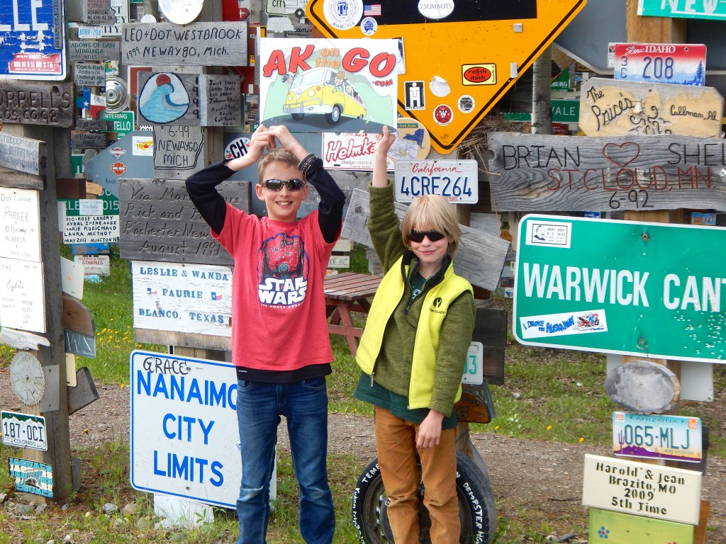 AK Kid and Best Buddy hang out at the Signpost Forest in Watson Lake. Erin Kirkland/AKontheGO