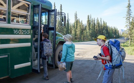 Danielle Benson's kids load the shuttle bus at Denali National Park's Teklanika campground.