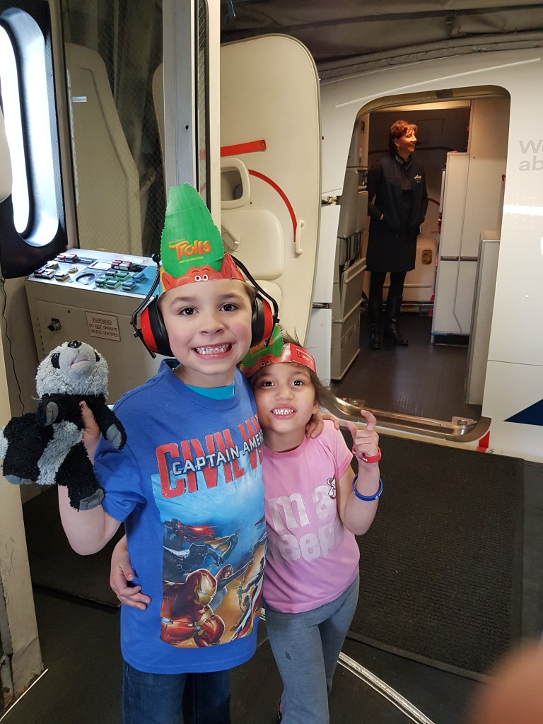 Two happy passengers get ready to board their Alaska Airlines mock flight. Ear muffs help kids who become anxious with loud noises or overstimulation. Erin Kirkland/AKontheGo