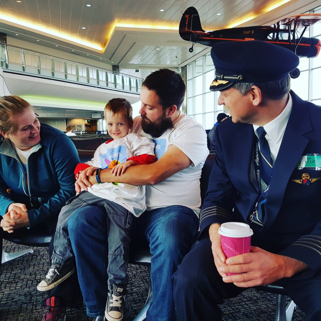 Alaska Airlines Captain Jim meets families waiting to board their Wings For Autism flight at Ted Stevens Anchorage International Airport. Erin Kirkland/AKontheGO