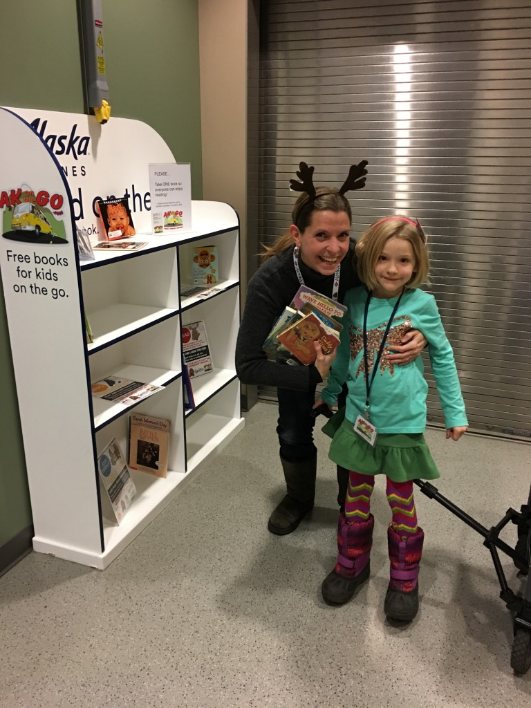 Two adorable Read On the Fly elves help stock bookshelves over the Thanksgiving holiday. Javier Robinson, TSAIA photo